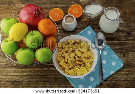 Healthy breakfast. Cornflakes, milk, honey, yogurt, exotic fruits in a basket,  flat lay. Healthy lifestyle. - stock photo