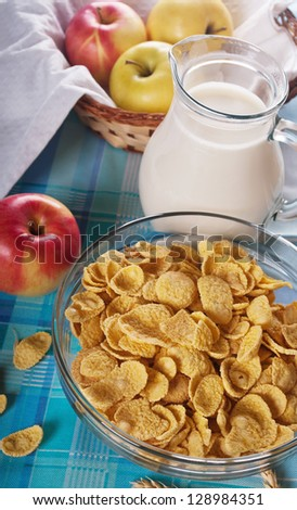 healthy breakfast: cornflakes with milk and  apples