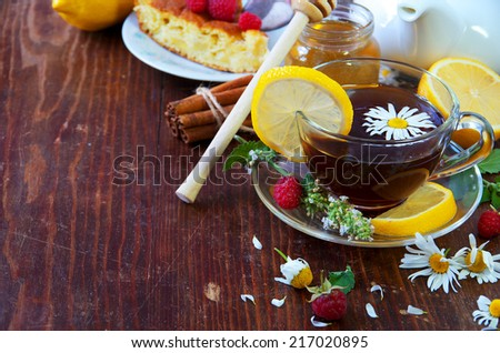 Healthy Breakfast. English tea with lemon.  Herbal tea and honey on wooden background