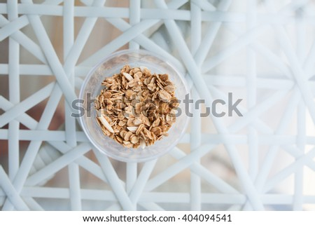 Healthy breakfast. Fresh granola, muesli in a glass cup. copy space.Organic oat,almond and sunflower seeds - stock photo