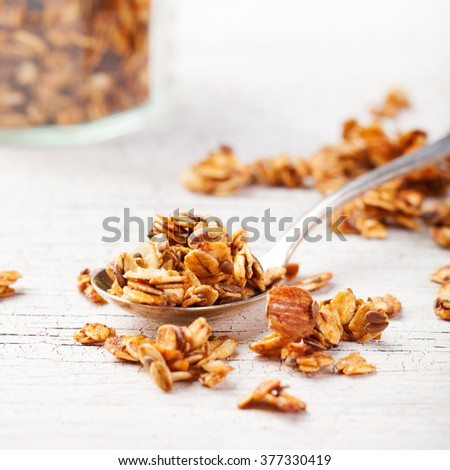 Healthy breakfast. Fresh granola, muesli in a glass jar Organic oat, almond and sunflower seeds - stock photo