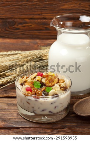 Healthy breakfast - granola with fruits and oat - stock photo