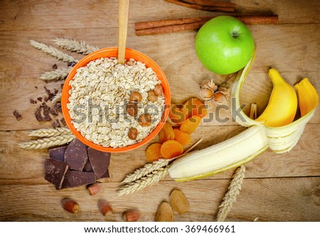 Healthy breakfast (healthy meal) - oatmeal and fruits - stock photo