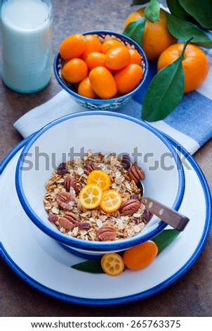 Healthy Breakfast, Homemade Oatmeal with kumquats, Granola - stock photo