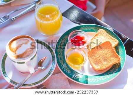 Healthy breakfast in restaraunt resort outdoor - stock photo