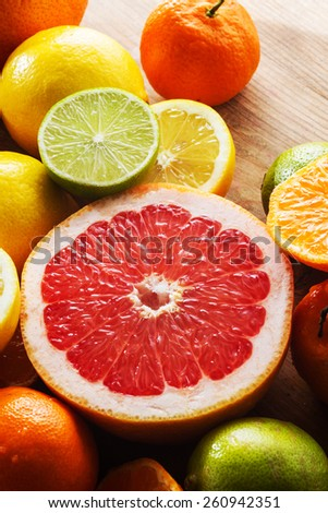 Healthy breakfast: lemons, limes, grapefruit, clementines. - stock photo