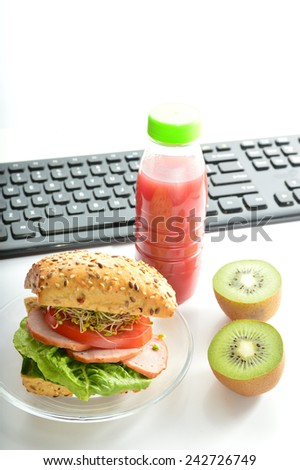 Healthy breakfast, lunch to work. Sandwich with ham and kiwi.