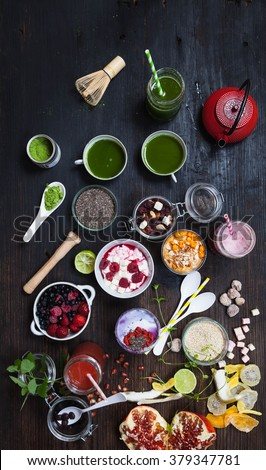 Healthy Breakfast - matcha green tea, cocnut milk and berries smoothie bowl with superfood ingredients, Clean eating breakfast concept, top view, white wooden table, rustic style,  - stock photo