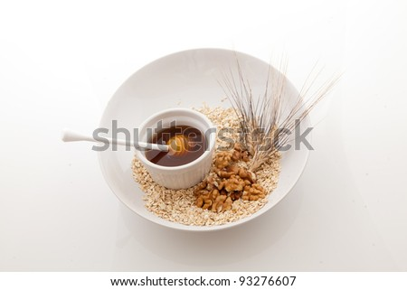 Healthy breakfast meal of oats walnuts and honey - stock photo