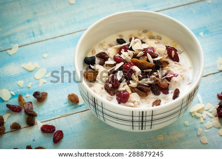 Healthy Breakfast - Oatmeal with dried fruit at blue table
