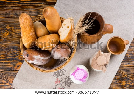 Healthy breakfast of assorted freshly baked crusty gourmet breads and milk served in bottles, overhead view