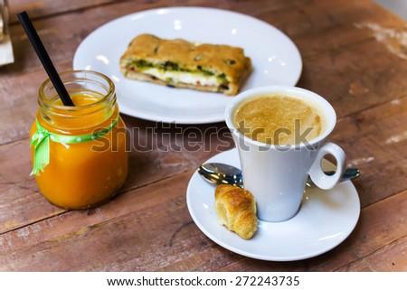 Healthy breakfast of coffee, vitamin C juice and vegetal snack - stock photo