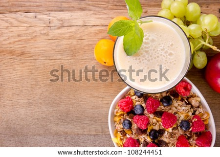 Healthy breakfast on wooden table, focused on drink. - stock photo