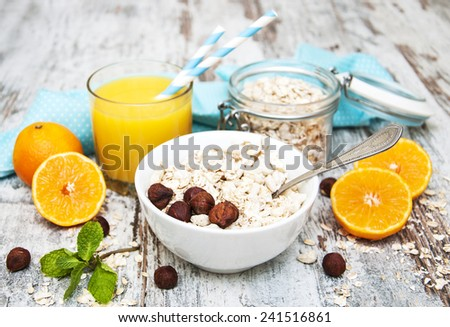 Healthy breakfast - orange juice  and muesli with nuts - stock photo