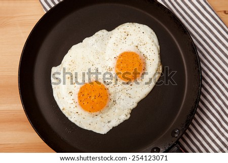 Healthy breakfast. Scrambled eggs with vegetables. - stock photo