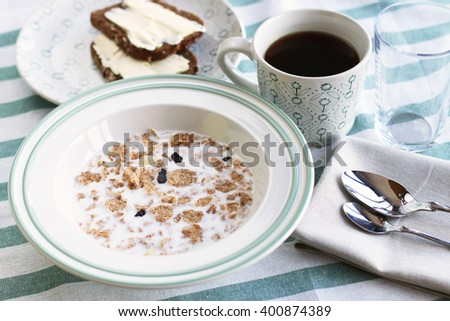 Healthy Breakfast with coffee, corn flakes, milk and toast with butter - stock photo