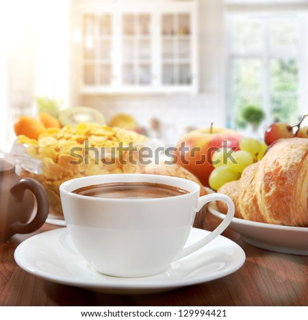 healthy breakfast with coffee in sunny morning - stock photo