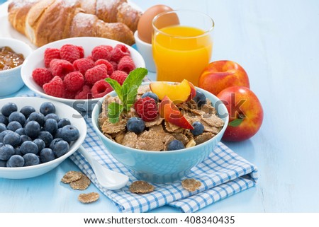 healthy breakfast with flakes, fresh fruit and berries, horizontal - stock photo