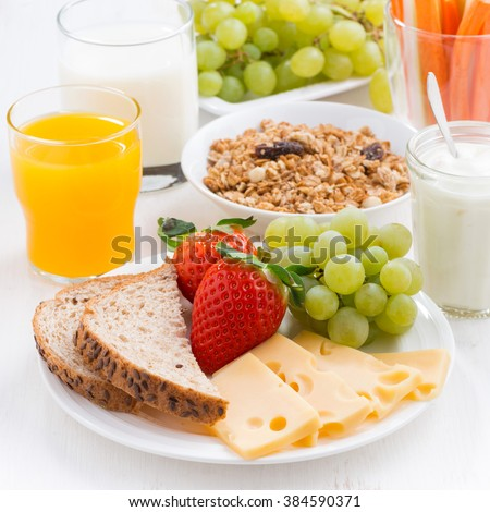 healthy breakfast with fresh fruits and vegetables, closeup - stock photo