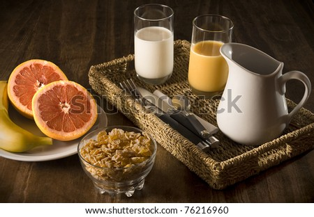 Healthy breakfast with fruit, cereals and milk. - stock photo
