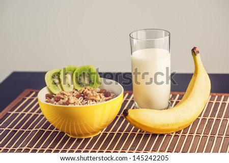 Healthy breakfast with fruit, milk and porridge in a retro style - stock photo