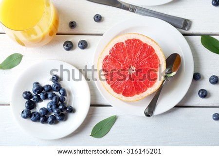 Healthy breakfast with fruits and berries on table close up - stock photo