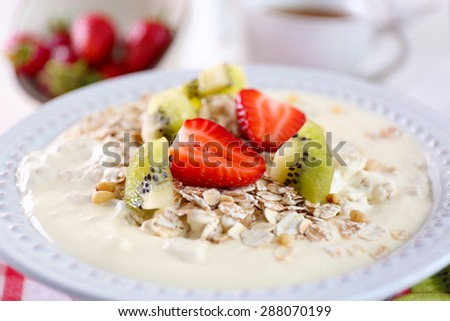 Healthy breakfast with homemade oatmeal, close up - stock photo