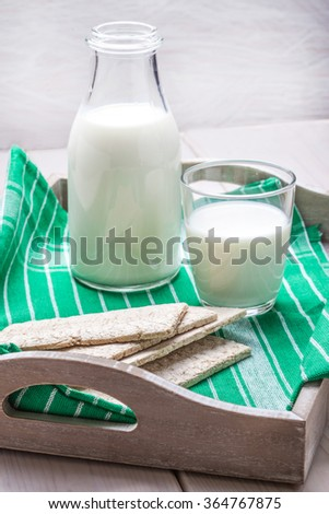 Healthy breakfast with milk and crisp bread. - stock photo