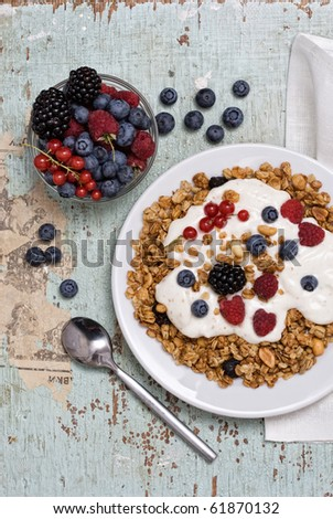 Healthy Breakfast with muesli on textured background - stock photo