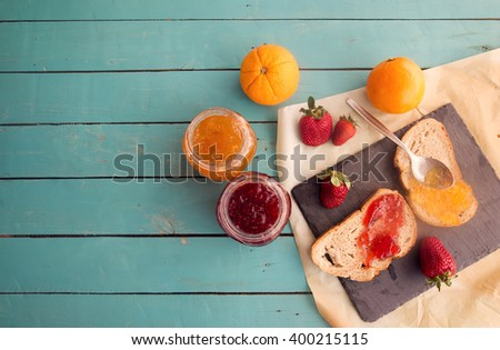 Healthy breakfast with orange and strawberry jam - stock photo