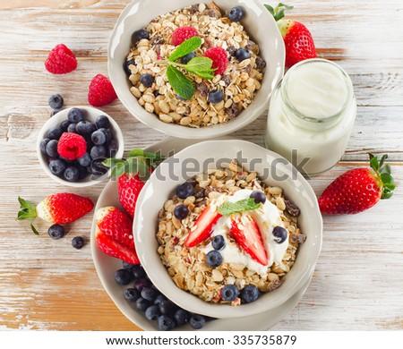 Healthy Breakfast with ripe  berries, yogurt and muesli. Selective focus - stock photo