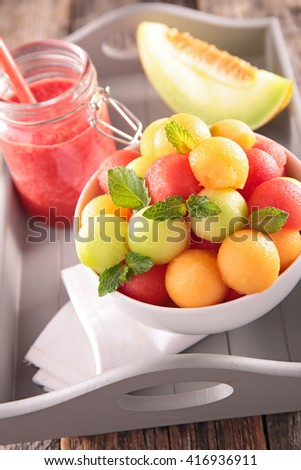 healthy breakfast with smoothie and fruit salad