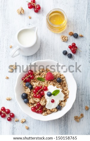 healthy breakfast with yogurt and granola  - stock photo