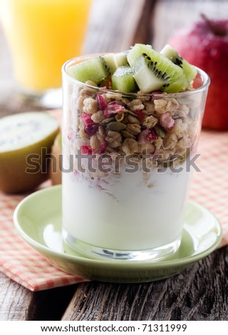 Healthy breakfast with yogurt and muesli, selective focus