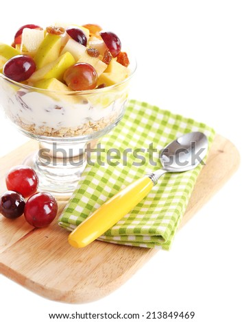 Healthy breakfast - yogurt with  fresh grape and apple slices and muesli served in glass bowl on wooden tray, isolated on white - stock photo
