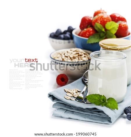 Healthy breakfast - yogurt with muesli and berries - health and diet concept - stock photo