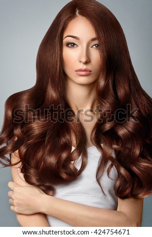 Healthy Brown Hair. Beautiful woman with Gorgeous Hair. Hairstyle. - stock photo