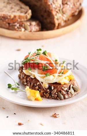 healthy brunch top with smashed egg, pickled onion and smoked salmon