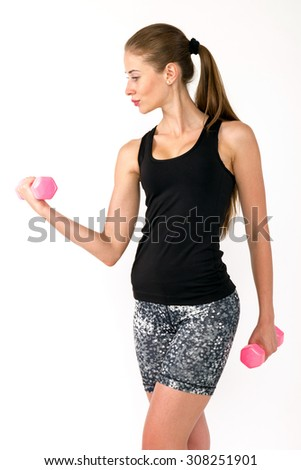 Healthy caucasian woman with dumbbells working out on white background. fitness gym concept
