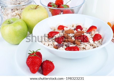 Healthy cereal with milk and fruits close up