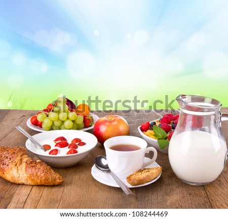 Healthy cereals breakfast with nature blur background - stock photo