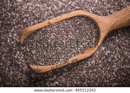 Healthy Chia seeds with wooden spoon, overhead view