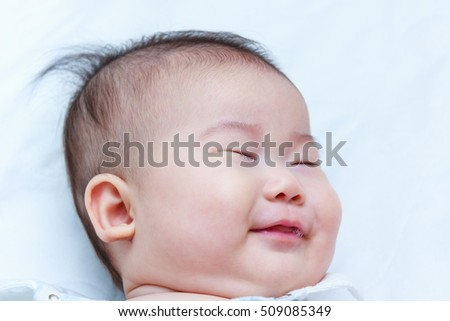 Healthy children. Closeup cute asian baby sleep sweet dreams. A three months adorable sleeping baby girl, on white background.