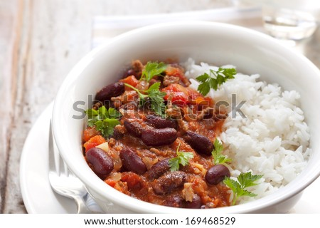 Healthy chilli con carne with rice.   - stock photo