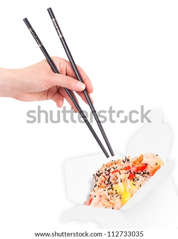 Healthy Chinese food in a container with woman hand holding chopsticks isolated