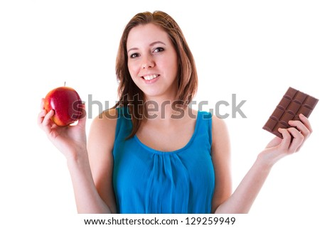 Healthy choice between an apple and chocolate bar