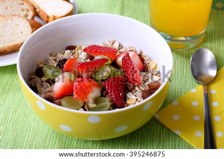 Healthy colorful breakfast: cereals with fresh fruits and fresh orange juice