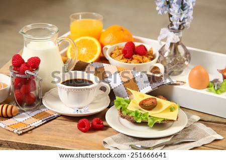 healthy continental breakfast on wooden table - stock photo