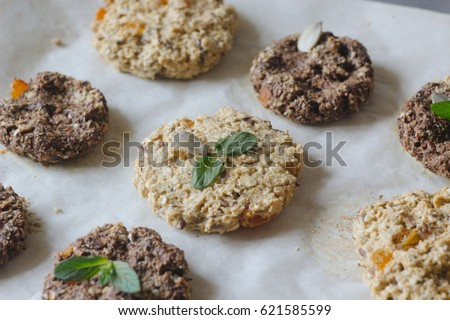 healthy cookies with oat, flax seeds and dried apricots on a backing paper background