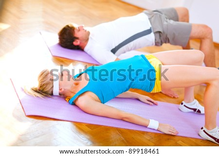 Healthy couple in an aerobics class - stock photo